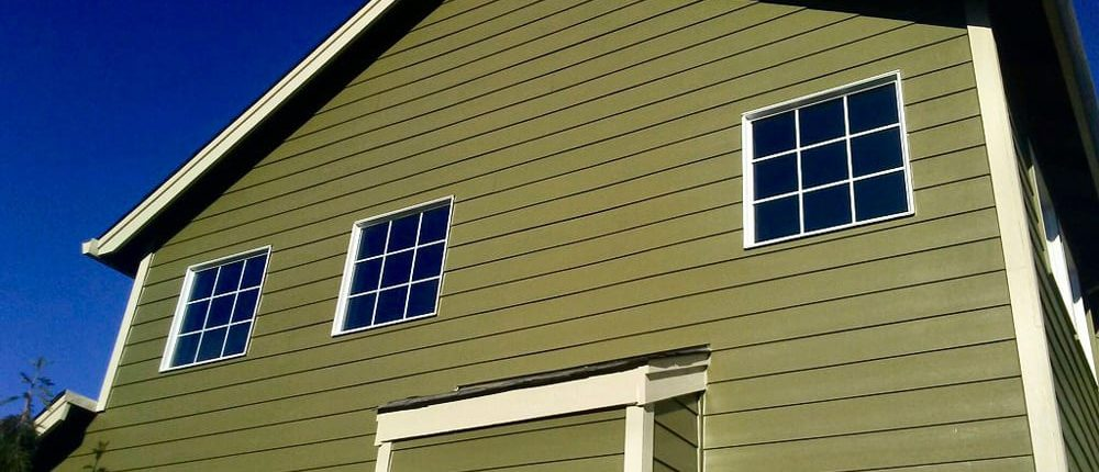 example of new paint on green home