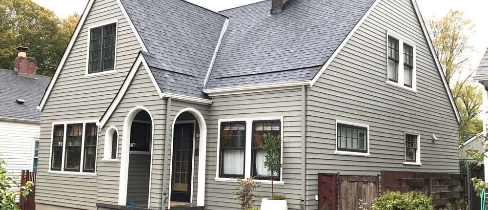 completed roofing on a taupe portland home