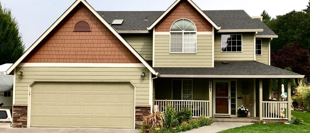 tan hardie plank siding with brown accents