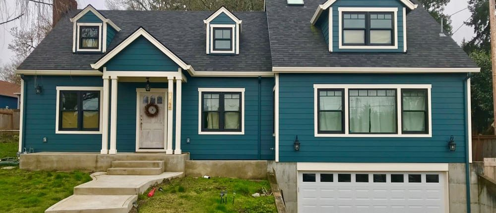 siding example of dark teal home