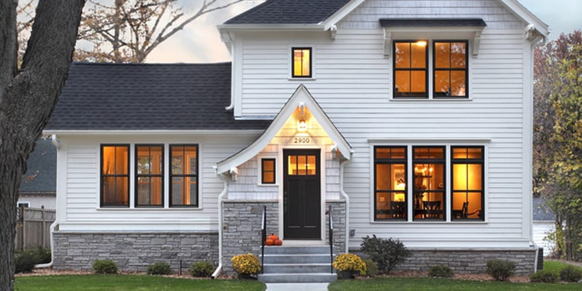 beautiful white house showing example of hardie plank siding work