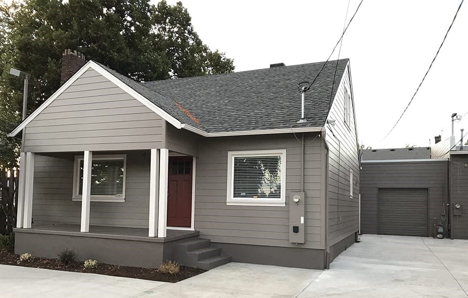 Portland home after new grey siding install with purple door