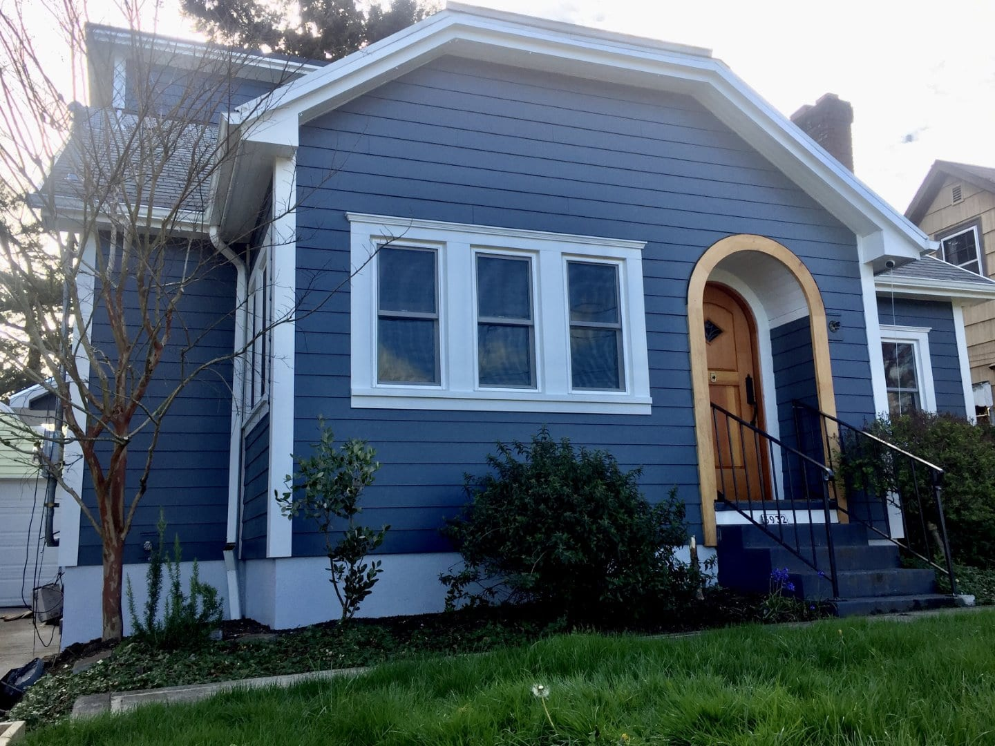 After install of James Hardie ColorPlus Smooth Siding Window Sills Crown Molding 5K Gutters & New Paint on Eves Foundation in Portland
