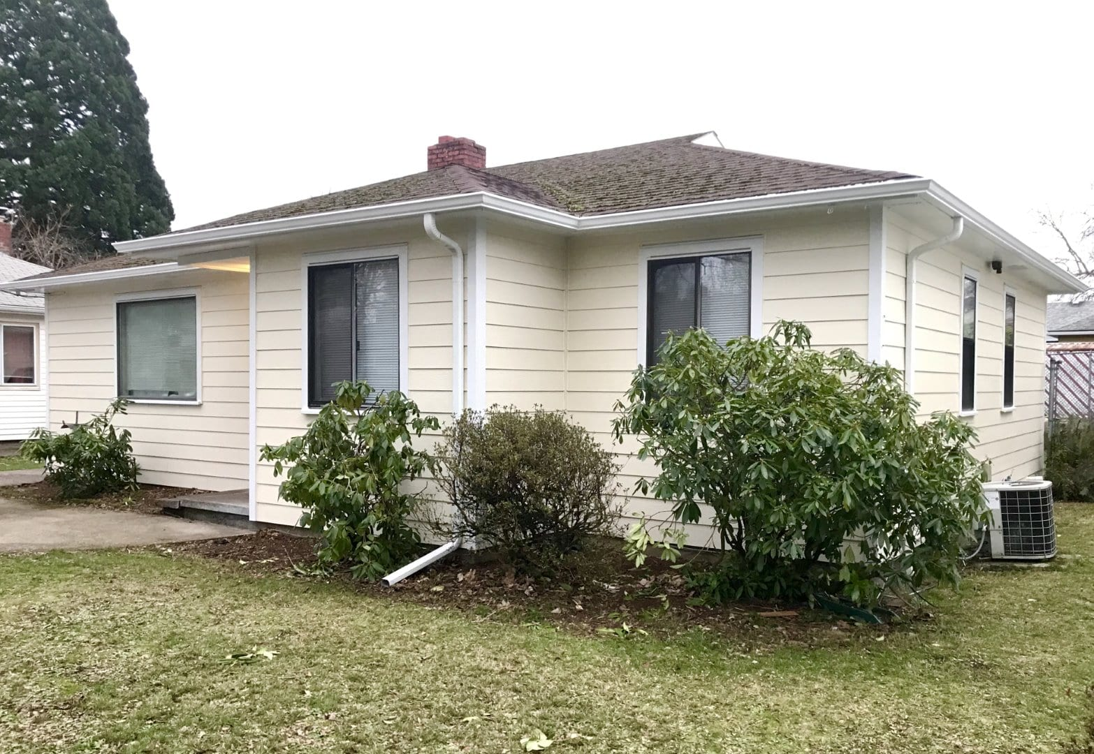After - ColorPlus James Hardie Siding, Painted Eves & New Gutters in SE Portland home