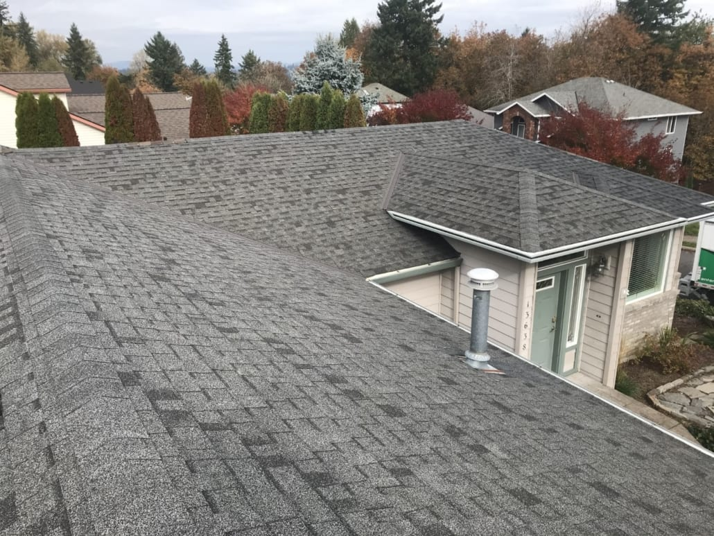Before photo of worn out roofing shingles at Portland home