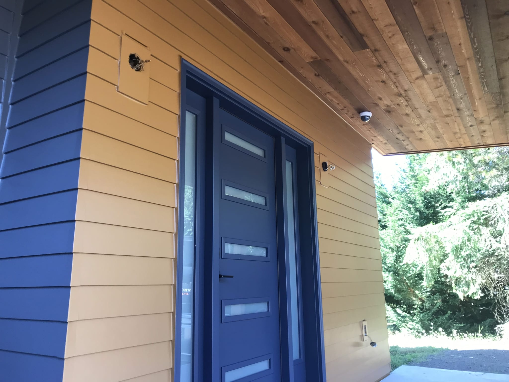 Finished Siding installation in Portland front door