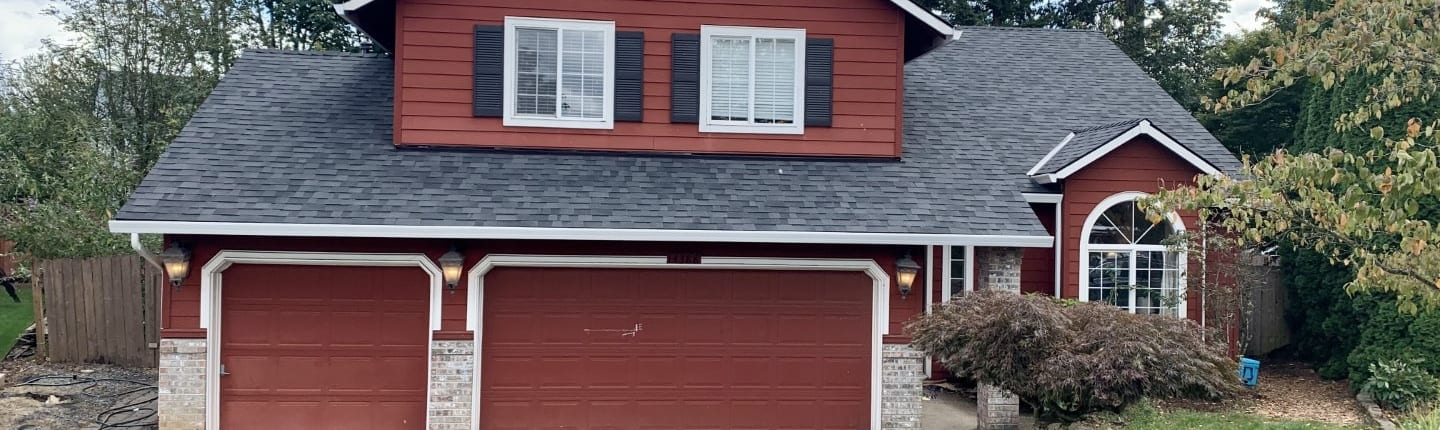 After new roofing installation - Black Shingle Roof & New White Gutters