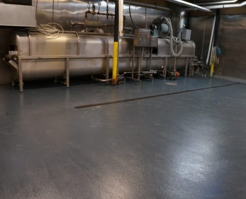 Epoxy commercial flooring installation at Tommyknocker brewing in Idaho Springs Colorado