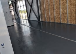 Urethane commercial floor install with epoxy topcoat at Nordic Brew Works in Montana