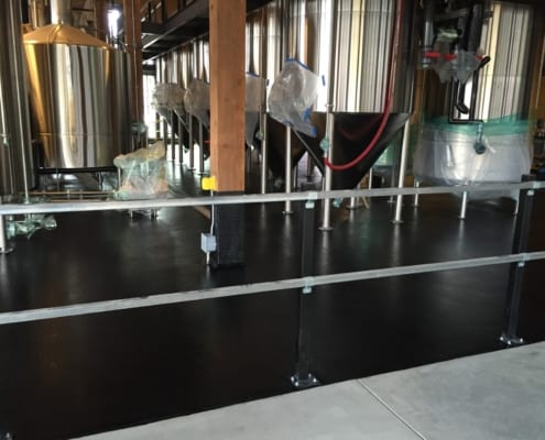 Black epoxy brewery flooring installation in Seattle Washington