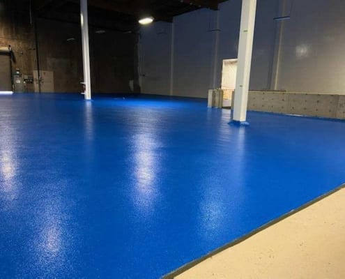 Finished epoxy urethane commercial food processing facility flooring system